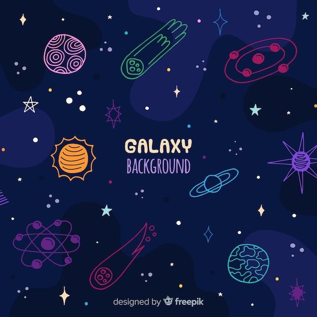 Fundo de galáxia de mão desenhada Vetor grátis