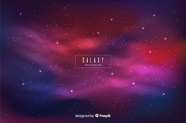 Fundo de galáxia nebulosa colorido Vetor grátis