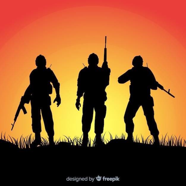 Fundo de guerra com silhuetas de soldados Vetor grátis