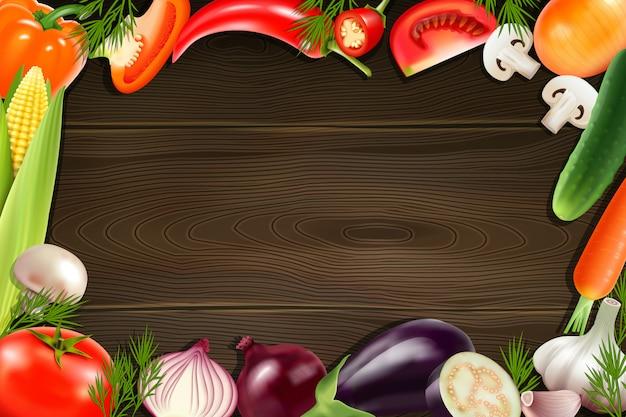 Fundo de madeira marrom com moldura composta de vegetais inteiros e fatiados coloridos Vetor grátis