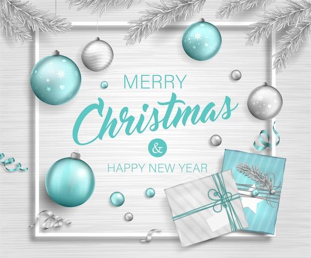 Fundo de natal com caixas de presente, enfeites em galhos de árvores e guirlandas Vetor Premium