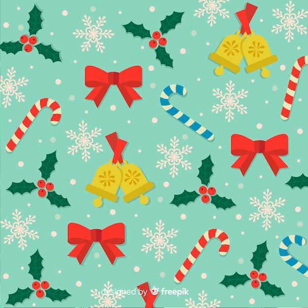 Fundo de natal com fitas de doces e sinos Vetor grátis
