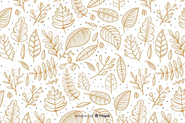 Fundo de outono mão desenhada com folhas Vetor grátis