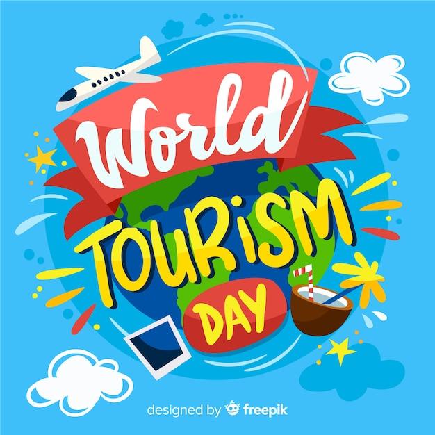 Fundo de rotulação do dia mundial do turismo criativo Vetor grátis