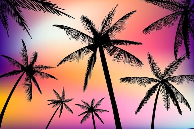 Fundo de silhuetas de palmas Vetor grátis