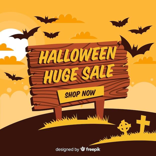 Fundo de vendas de halloween com sinal de madeira Vetor grátis