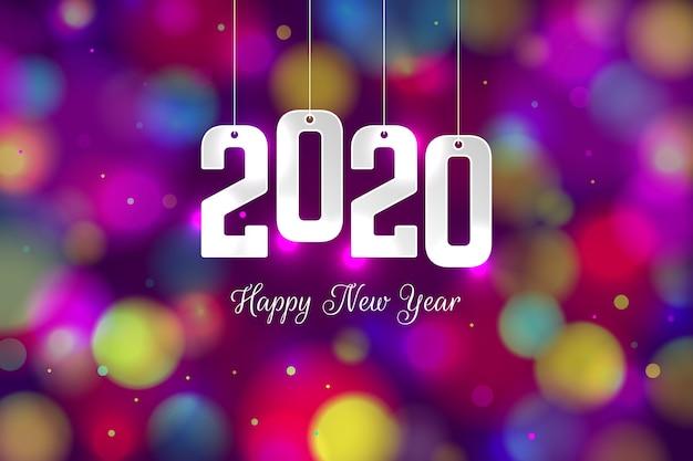 Fundo desfocado colorido do ano novo 2020 Vetor grátis
