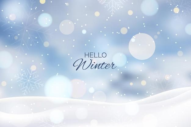 Fundo desfocado de inverno com saudação Vetor Premium