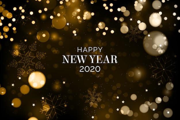 Fundo desfocado do ano novo 2020 Vetor grátis