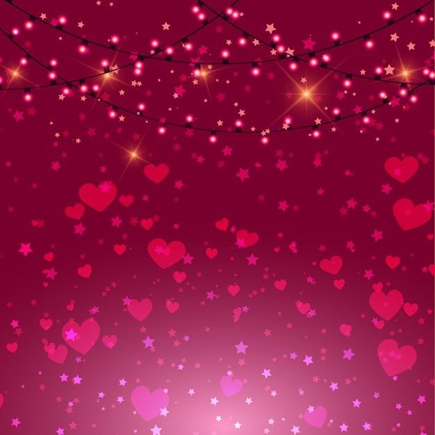 Fundo dia dos namorados com corações rosa e luzes Vetor grátis