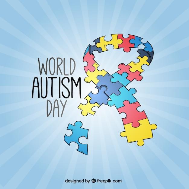 Fundo do dia fita do autismo feito de peças do puzzle Vetor grátis