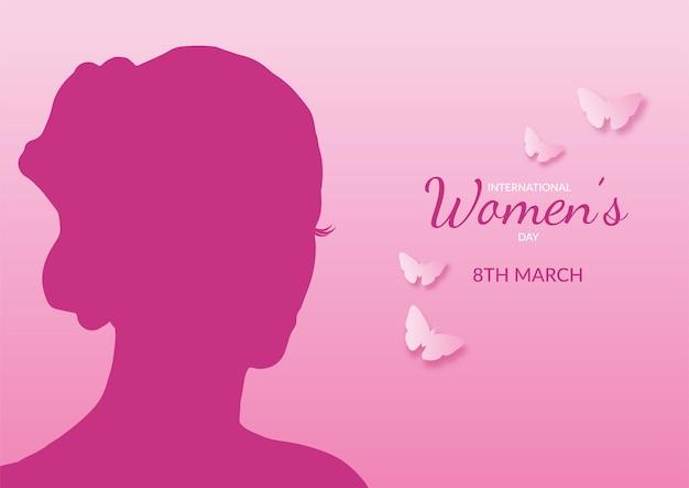 Fundo do dia internacional da mulher com silhueta feminina e borboletas Vetor grátis