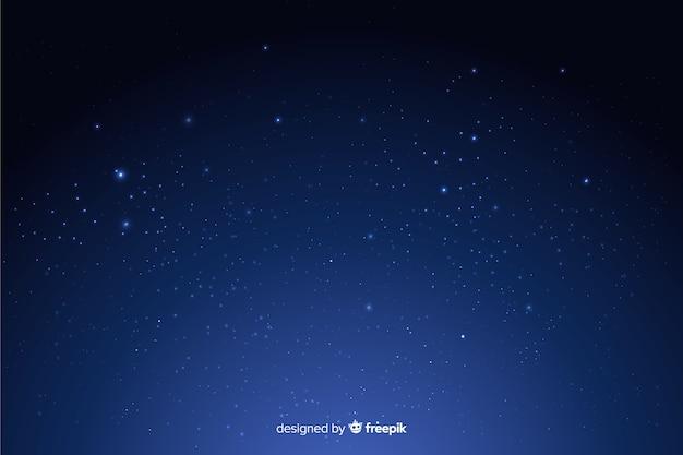 Fundo escuro de noite estrelada gradiente Vetor grátis