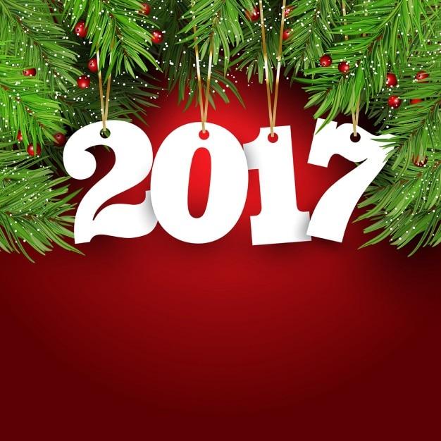 Fundo feliz ano novo com abeto ramos de árvore bagas e números de suspensão Vetor grátis