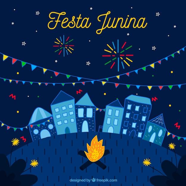 Fundo festa junina com cidade e fogos de artifício Vetor grátis