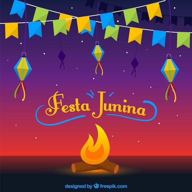 Fundo festa junina com fogueira e bandeirolas Vetor grátis