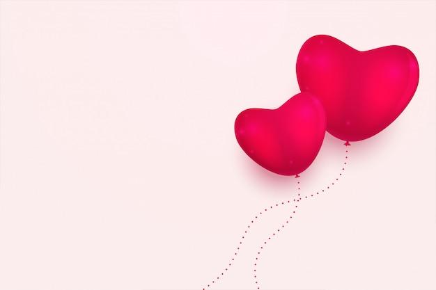 Fundo mínimo de corações rosa com espaço de texto Vetor grátis