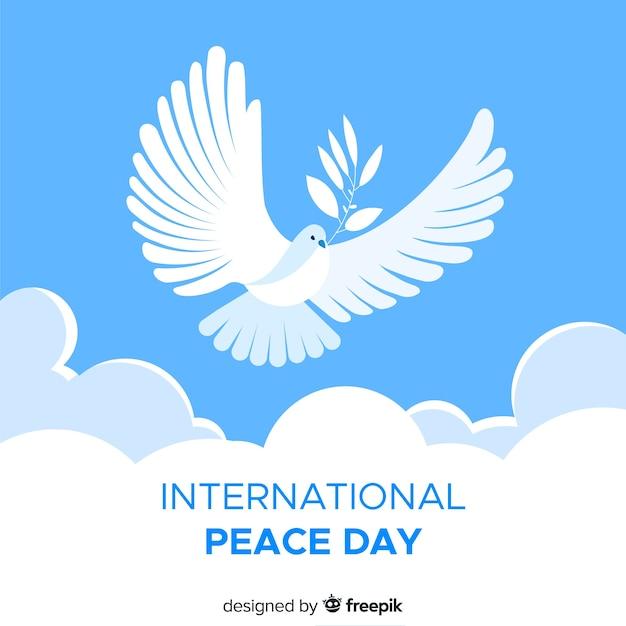 Fundo plano de dia de paz com pomba Vetor grátis