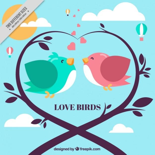 Fundo romântico com pássaros e coração feito de ramos Vetor grátis