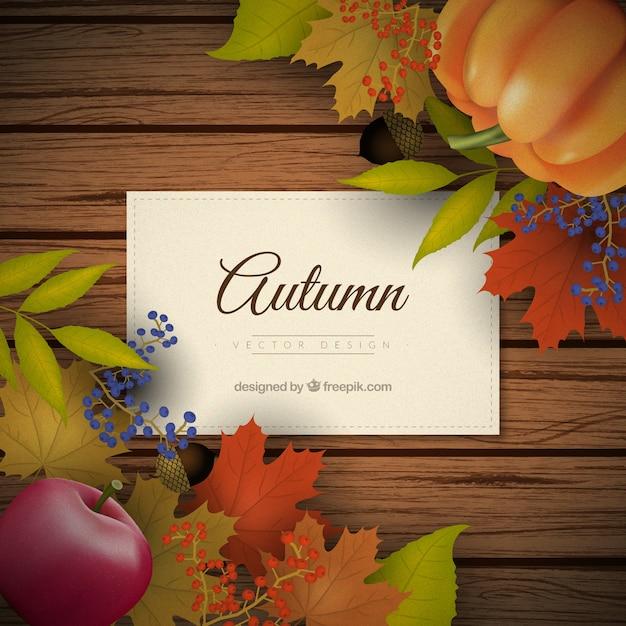 Fundo tábuas de madeira com decoração do outono no estilo realista Vetor grátis