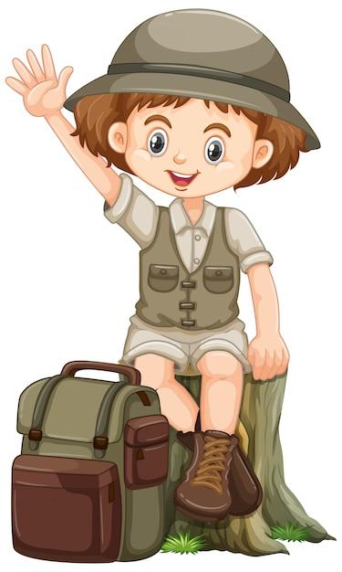 Garota com roupa de safari, acenando com a mão e sentado no log Vetor grátis