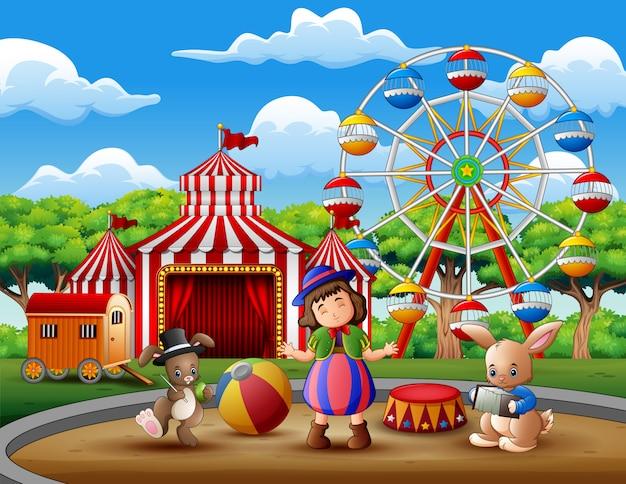 Garota feliz na fantasia com um circo de coelhos na arena Vetor Premium
