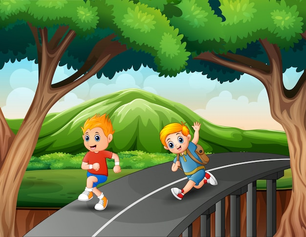 Garotinhos correndo na estrada Vetor Premium