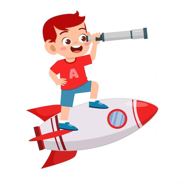Garoto bonito garoto feliz montar foguete com telescópio Vetor Premium