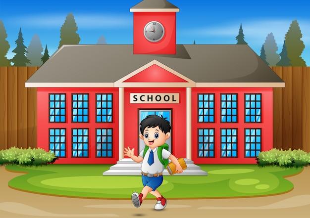 Garoto feliz, indo para casa depois da escola Vetor Premium