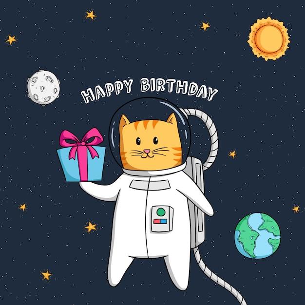 Gato bonito astronauta voando no espaço, segurando a caixa de presente de aniversário Vetor Premium