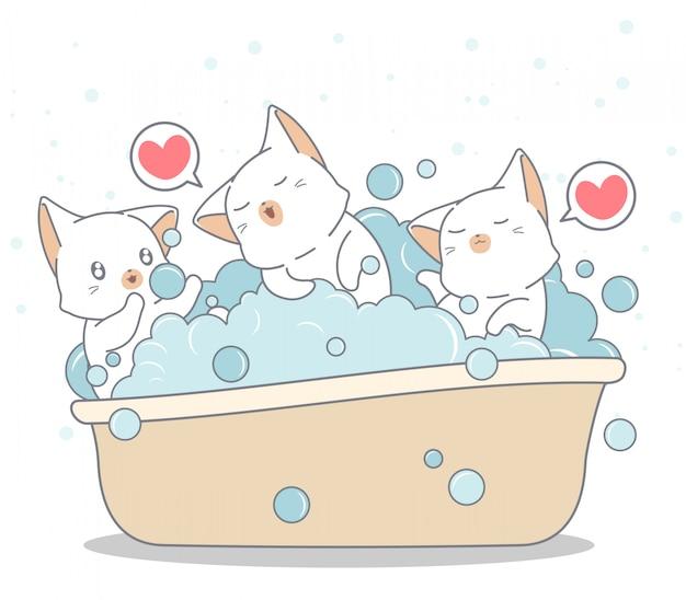 Gatos adoráveis estão tomando banho na banheira Vetor Premium