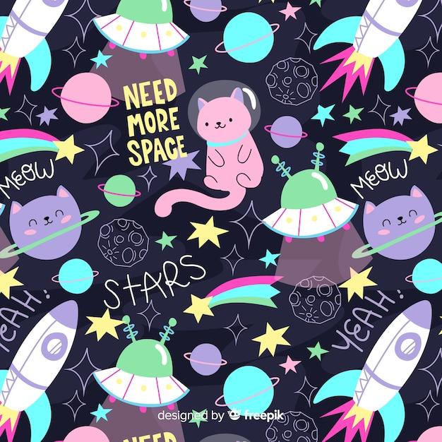 Gatos coloridos do doodle no espaço e no teste padrão das palavras Vetor Premium