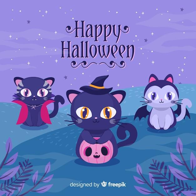 Gatos de halloween com design plano Vetor grátis