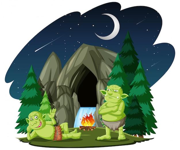 Goblin ou troll com estilo de desenho animado de caverna de pedra isolado no fundo branco Vetor grátis