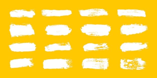 Grande coleção de tinta branca, pinceladas de tinta, pincéis, linhas, grungy. Vetor Premium