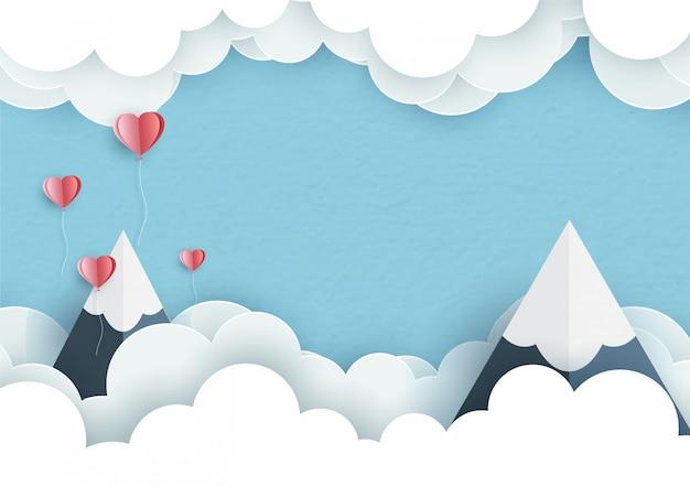 Grandes montanhas com pequenos corações e espaço para textos em nuvens brancas sobre fundo azul Vetor Premium