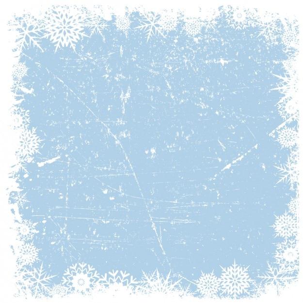 Grounge flocos de neve no fundo gelado quadro Vetor grátis