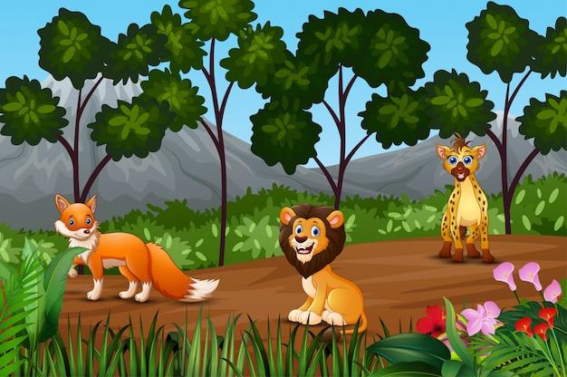 Grupo de animais selvagens se reunindo na orla da floresta Vetor Premium