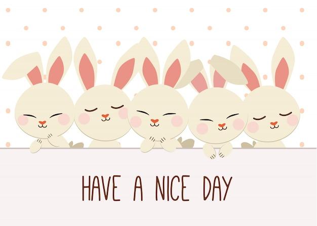 Grupo de coelhos com uma bolinha. tenha um bom dia Vetor Premium