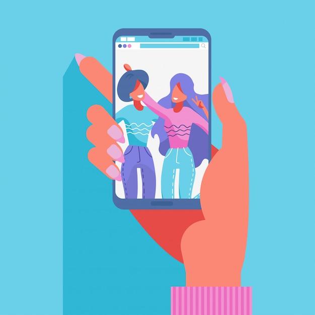 Grupo de duas amigas tirando uma foto com um smartphone Vetor Premium