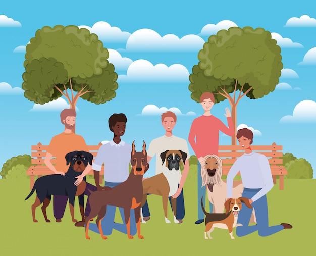 Grupo de homens com mascotes cachorros fofos no acampamento Vetor Premium