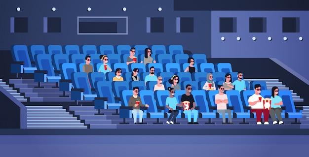 Grupo de pessoas vestindo óculos 3d assistindo filme sentado no cinema com pipoca e cola misturar corrida homens mulheres se divertindo rindo de nova comédia apartamento comprimento total horizontal Vetor Premium
