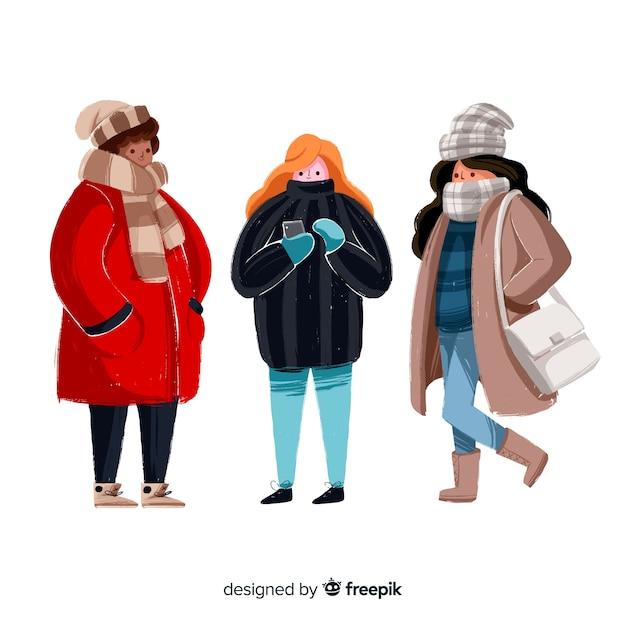 Grupo de pessoas vestindo roupas de inverno Vetor grátis