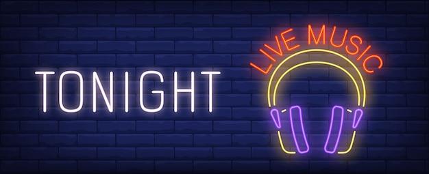 Hoje à noite sinal de néon de música ao vivo. Fones de ouvido brilhantes de dj na parede de tijolos. Vetor grátis