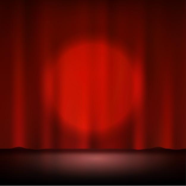 Holofote no palco vermelho cortina Vetor Premium