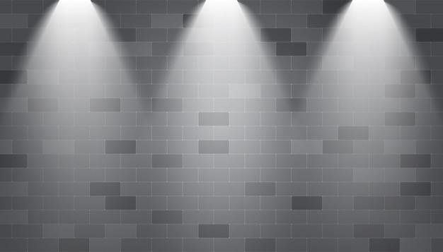 Holofotes de fundo iluminado em uma parede de tijolos Vetor Premium