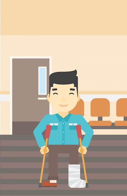 Homem com a perna quebrada e muletas. Vetor Premium