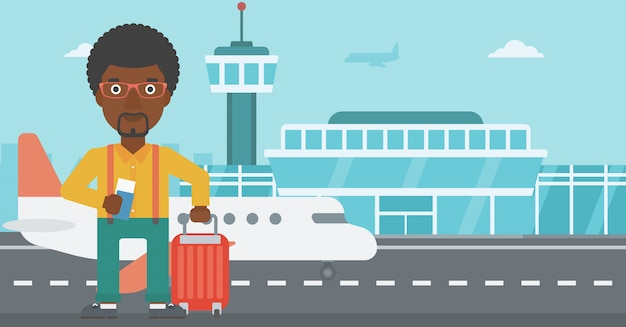 Homem com mala e bilhete no aeroporto. Vetor Premium