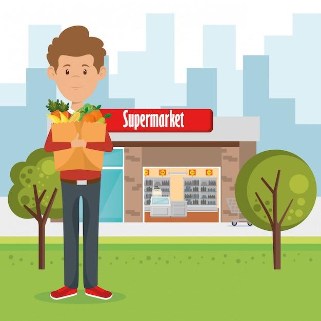 Homem com supermercado mantimentos na sacola de compras Vetor grátis
