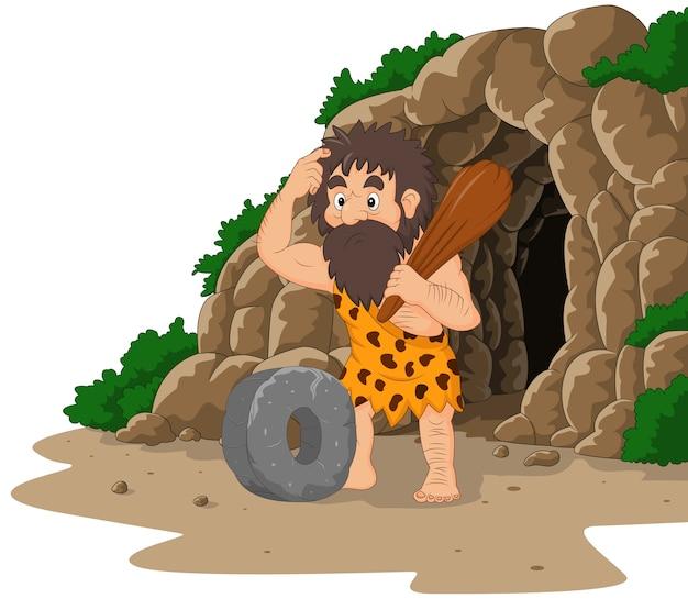 Homem das cavernas dos desenhos animados, inventando a roda de pedra com fundo de caverna Vetor Premium